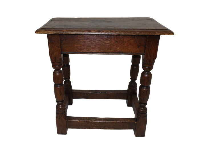 Handsomely aged and used oak stool, sturdy and sound, England, 19th century.