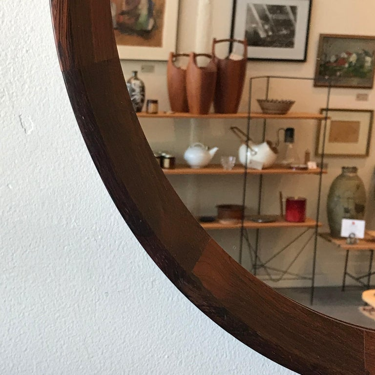 Circular rosewood mirror by Hans Gustav Ehrenreich of Denmark. Constructed of a matrix of solid rosewood pieces to create the 19.5