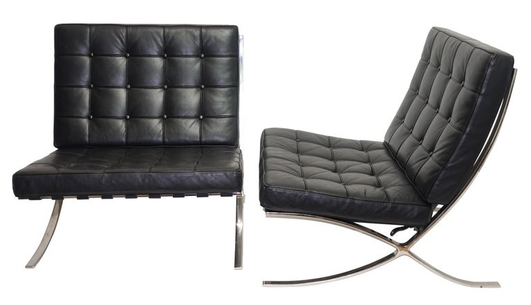 Two classic midcentury style Mies van der Rohe for Knoll Studio Barcelona style chairs with Spinneybeck black leather cushions and stainless steel frames. These chairs do not have tags or labels. American, last quarter of the 20th century. Will sell
