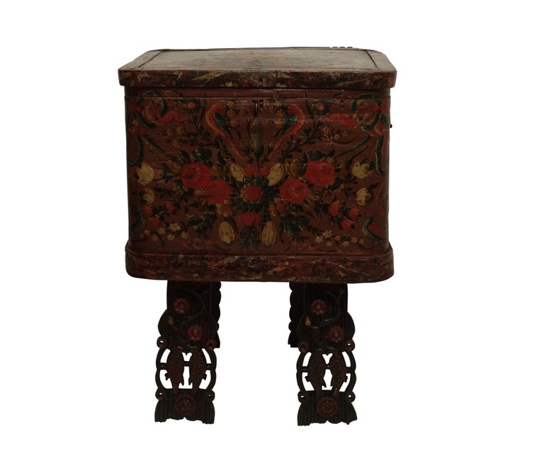 Colorful and brightly painted all-over with flowers and love birds, marriage or dowery chest on carved and painted legs, Scandinavian, circa 1800.