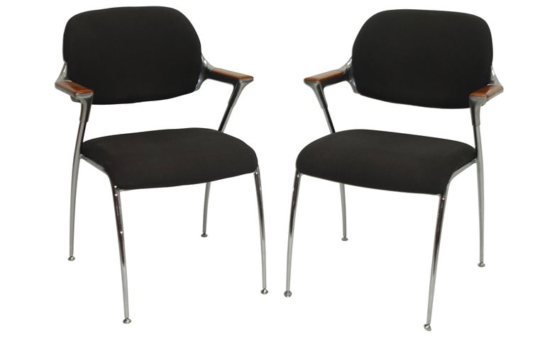 A pair of Thonet aluminum and chrome armchairs with wood inset on the arms. Original fabric shows signs of wear and age. Thonet, USA, circa 1970.