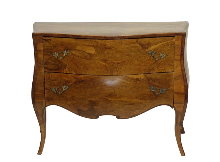 A shapely vintage olive wood and walnut two-drawer commode / chest of drawers with cabriole legs and brass pulls. Italian, circa 1950.