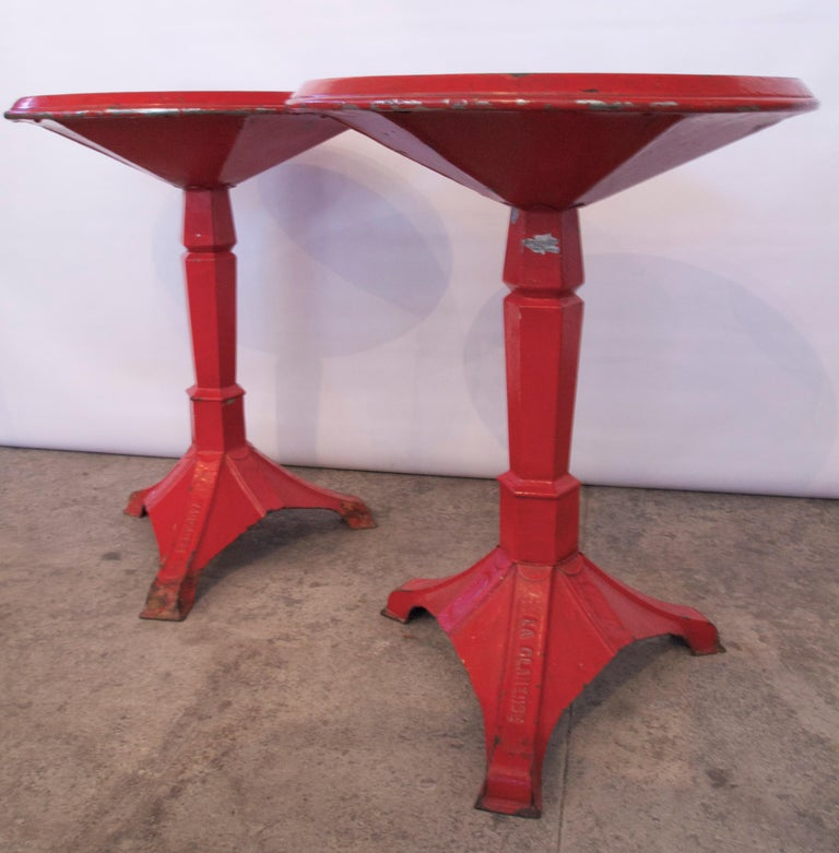 Wonderful pair of French Industrial/ Modern Art Deco Period red painted steel and cast Iron gueridon bistro tables. Manufactured in Cadenet / Departement of Vaucluse.