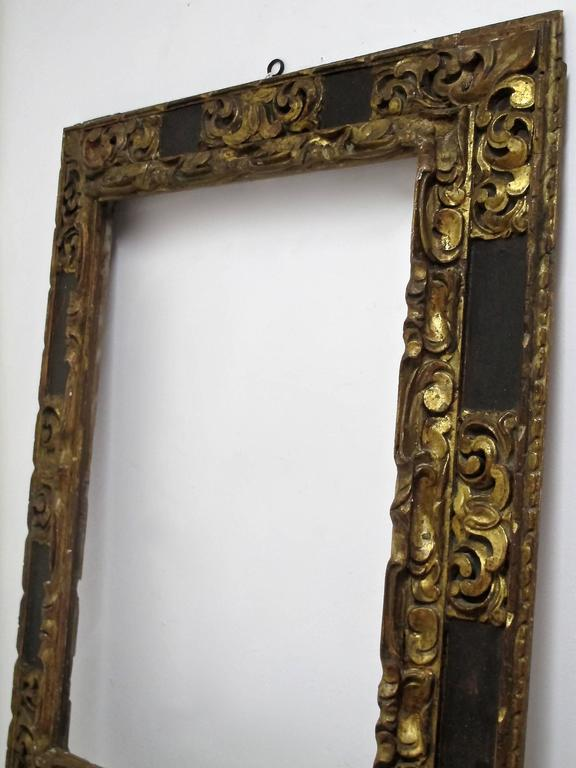 A truly extraordinary large carved, painted and gilded Spanish Colonial painting frame in original condition. The inside measurements on the frame are 33.5 X 25. Spain, 18th century.