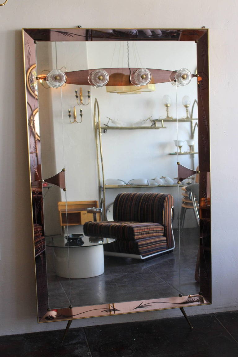 Italian 1950s full length mirror brass base and hand-cut mirror.