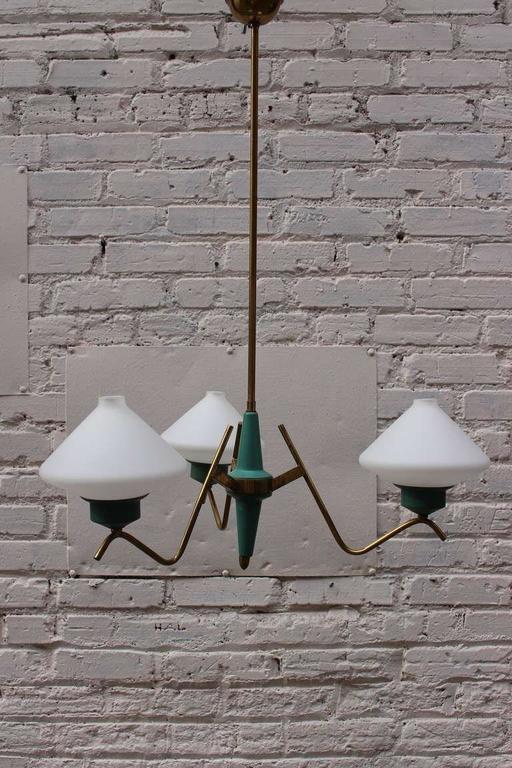 Italian chandelier, tree white opaline glass shades, brass base.