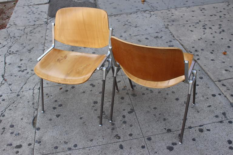 Four stackable Italian chairs. Frame polished aluminum; the legs are coated in plastic. The sitting surface and backrest made from the bent plywood. 