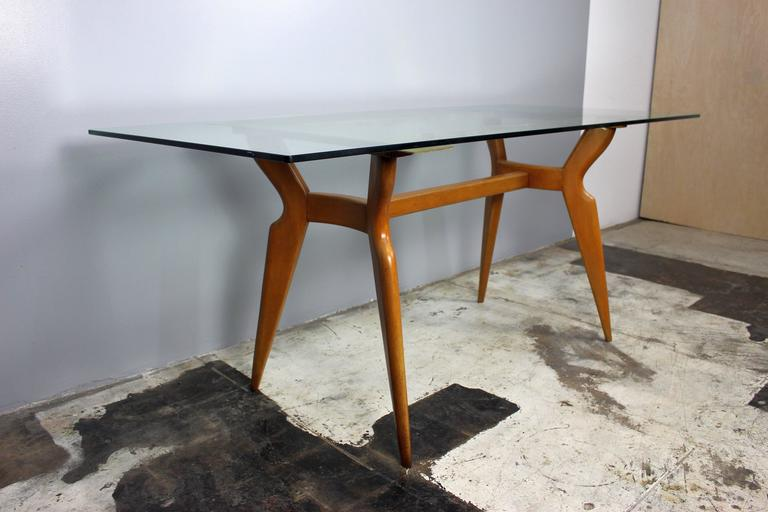 Table is in style of Gio Ponti all together nice look and essential Italian design