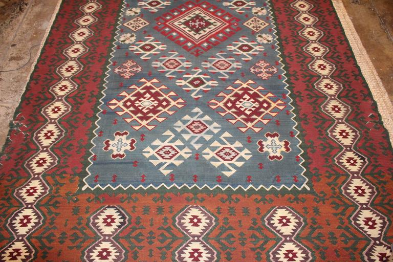 Turkish Killim from Balkan in original condition.Indigo center base 