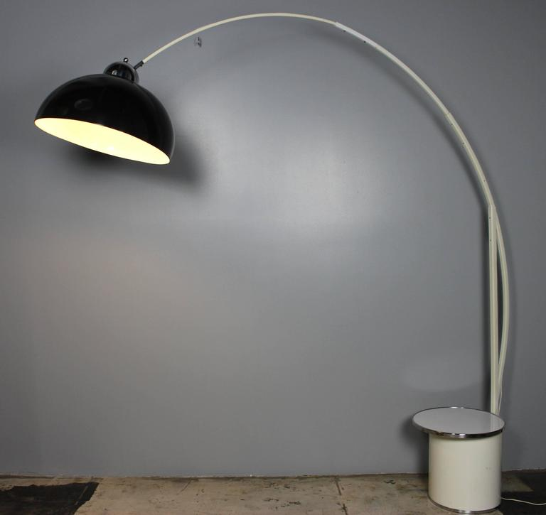 A large Italian 1970s floor lamp with the small cocktail table. Table is 16 inches in diameter.