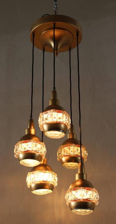 Five globe ceiling lights, hand cut-glass on the side and in the middle magnifying glass on metal base.