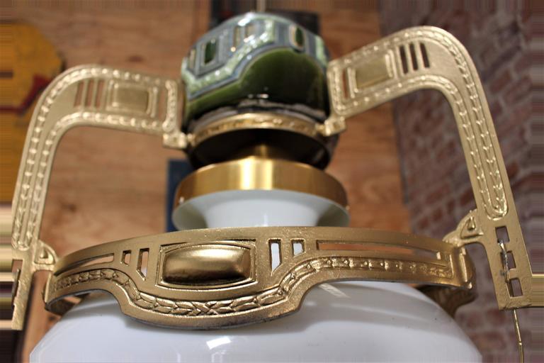 1900s Austrian glass and ceramic hand sculptured chandelier. Handmade metal base.