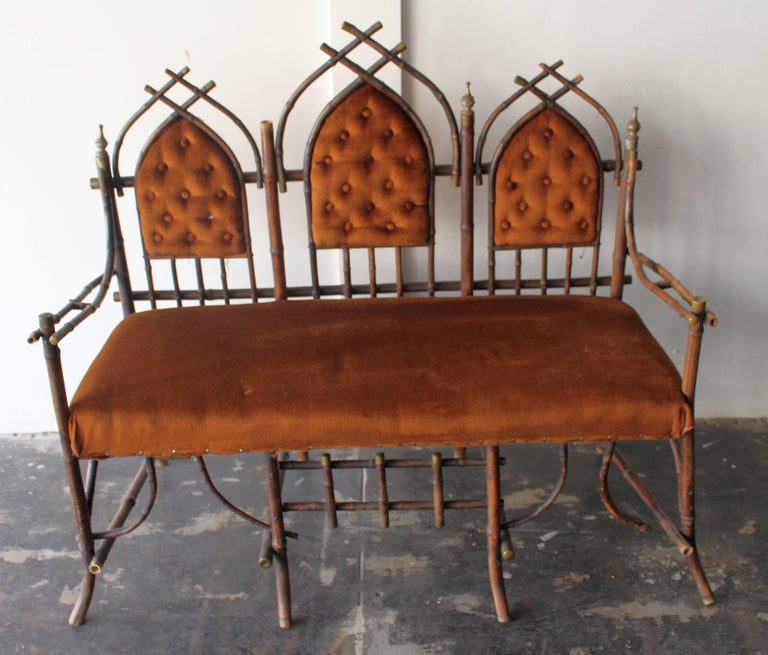 19th century French Victorian bamboo settee and  Chinoiserie  with the extendible  leaves.  Settee base  bamboo and brass buts upholstery velvet and Chinoserie hand painted tails base bamboo and brass buts .