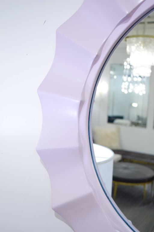 Finished in a soft lilac lacquer, this 1970's scalloped mirror is the perfect addition to today's decor.   Some crazing on Lacquered finish.