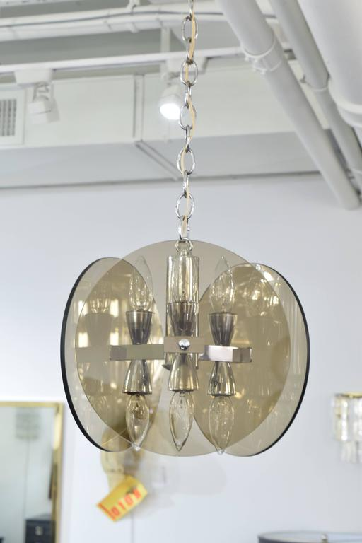 """A smoked glass chandelier in the manner of Fontana Arte, with three glass circles each with a diameter of 10"""" that holds up to 180 watts."""