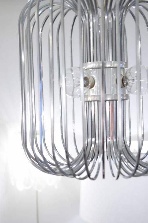This chandelier designed by Sciolari is constructed out of chrome in the signature