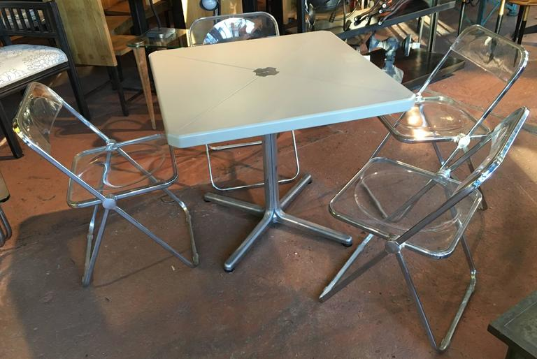 Modern metal folding card table and four plia chairs by for Contemporary game table and chairs