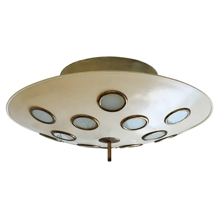 Imposing saucer shaped chandelier attributed to Arredoluce featuring twelve frosted glass lenses. The large conical stem, holds six regular sockets creating diffused light through the glasses as well as on the ceiling. Glass rims and finial are