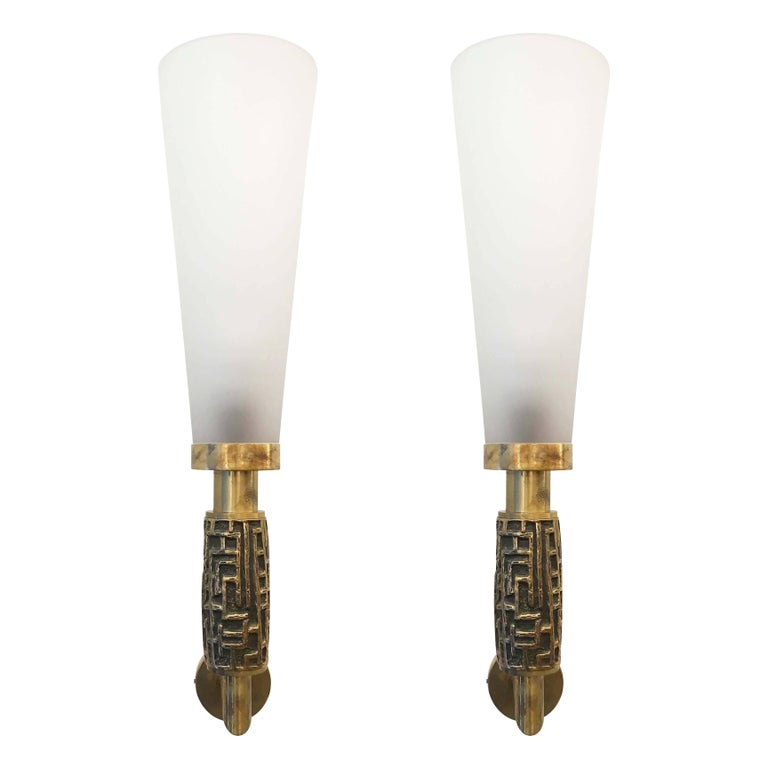 """Sculptural bronze and glass wall light by Luciano Frigerio. The glass is frosted creating a soft diffused light.  Condition: Excellent vintage condition, minor wear consistent with age and use.  Measures: Width 6.25""""  Depth 7.5""""  Height 26""""."""