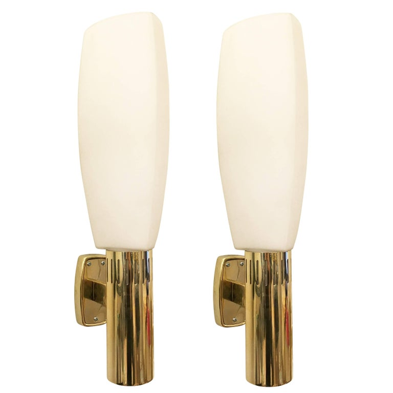 Large Stilnovo sconces with triangular frosted glass shades and polished brass frames. Each is marked on the backplate. Two with all bronze frames are also available.  Condition: Excellent vintage condition, minor wear consistent with age and use.
