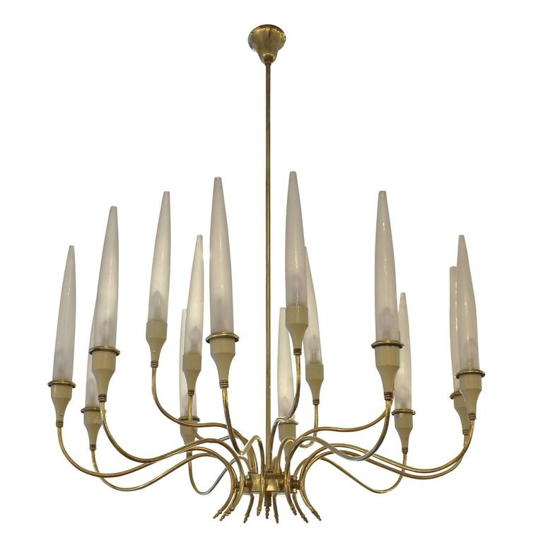 Exceptional 1940s-1950s chandelier in the manner of Angelo Lelli for Arredoluce. It is entirely made of brass except for the beige lacquered cups and frosted glass shades. Each of the fifteen arms holds one candelabra socket.