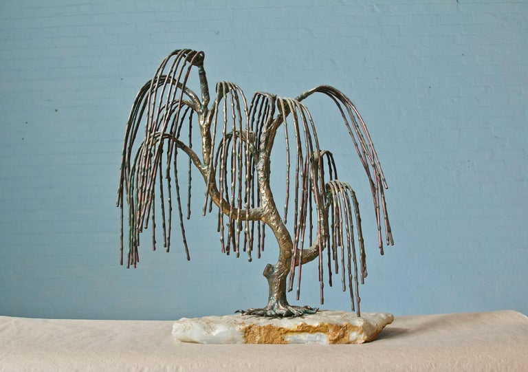 Very attractive weeping willow tree sculpture by Brian Bijan. Tree is made with mixed copper and brass metal supported by a quartz stone base. Stamped 110-250 on trunk.