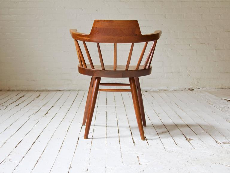 Rare George Nakashima Walnut Dining Set with Four Captain's Chairs In Good Condition In Brooklyn, NY
