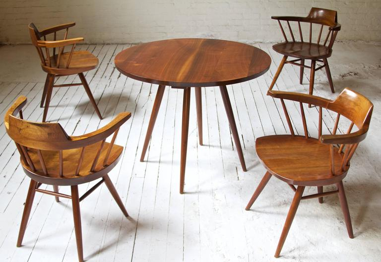 Rare single-owner dining set by George Nakashima featuring exceptionally-preserved splayed leg dining table and four carved-seat