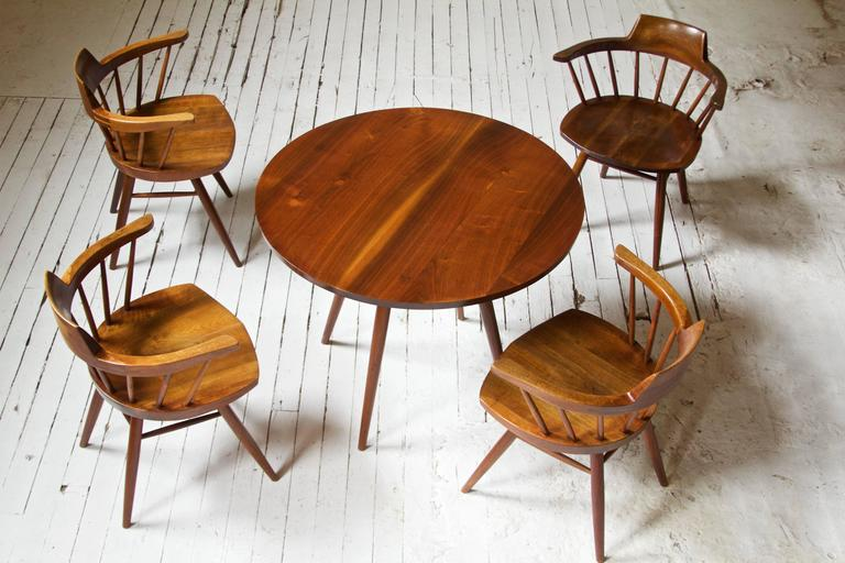 Mid-Century Modern Rare George Nakashima Walnut Dining Set with Four Captain's Chairs