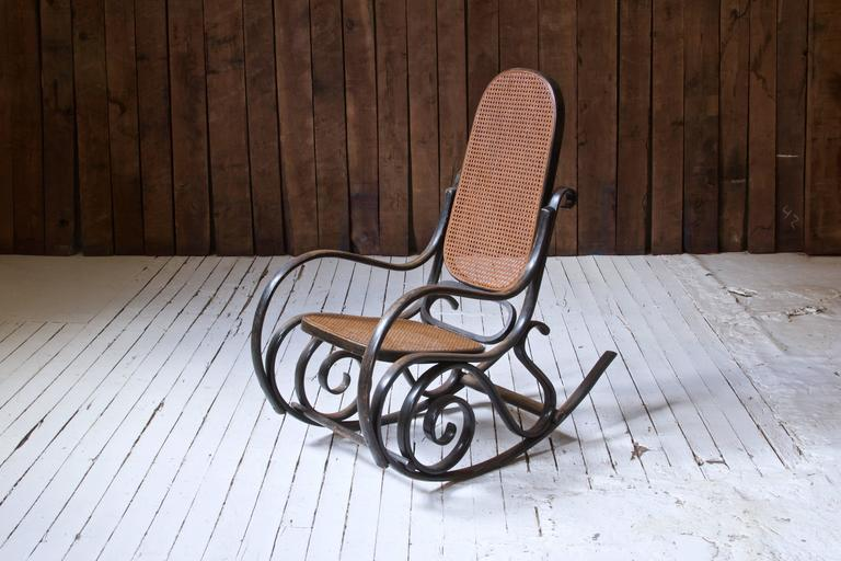 This design, the Thonet Model #10, is an iconic curvilinear rocking chair first conceived by the prolific Michael Thonet in the mid/late 19th century. Thonet efficiently outsourced production of many of his designs throughout the 19th and 20th
