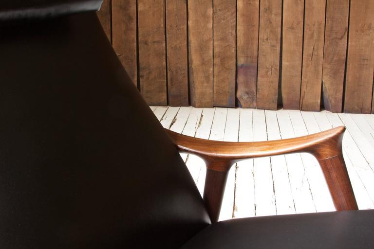 Carved Ingmar Relling for Westnofa Sculpted Teak and Black Vinyl Rocking Chair