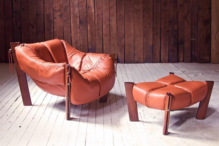 A well-preserved vintage Percival Lafer MP-211 Brazilian rosewood and leather lounge chair and ottoman made in Sao Paolo, Brazil by Lafer S.A Ind. e Com, circa 1975. This piece has come from the Carmel, NY estate of the original owner, has seen