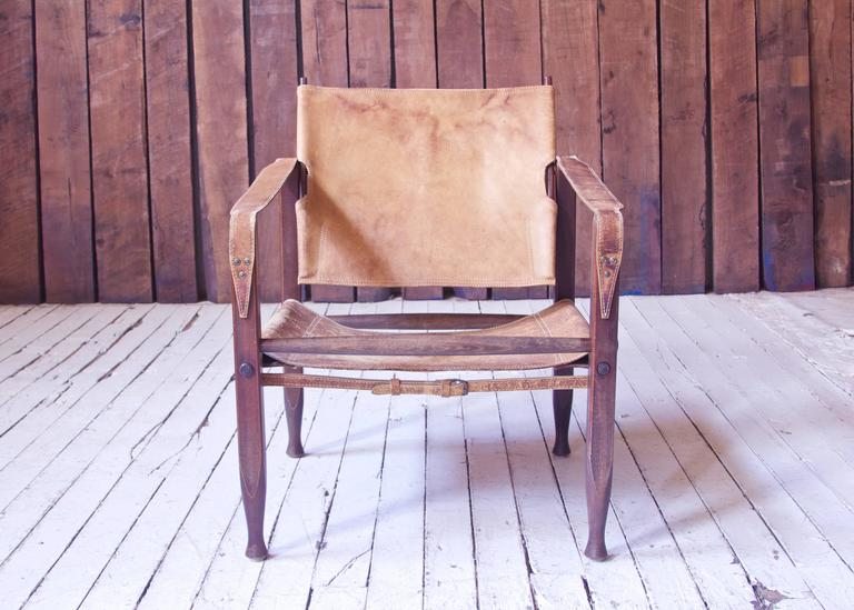 "Lovely early example of Kaare Klint's ever-popular ""Safari Chair"" in original cognac leather and stained Beech. Inspired by the collapsible Campaign chairs of English officers on the African Savannah, Klint designed his own modernized"