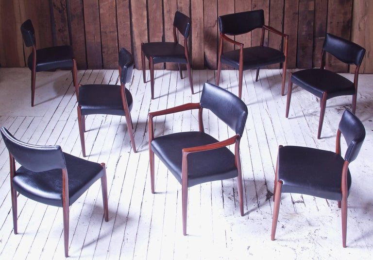 Stunning complete and original set of eight dining chairs, two of which are armchairs, designed by the prolific and multi-talented Danish design duo of Aksel Bender Madsen & Ejner Larsen, 1952; manufactured by Willy Beck. Excellent vintage