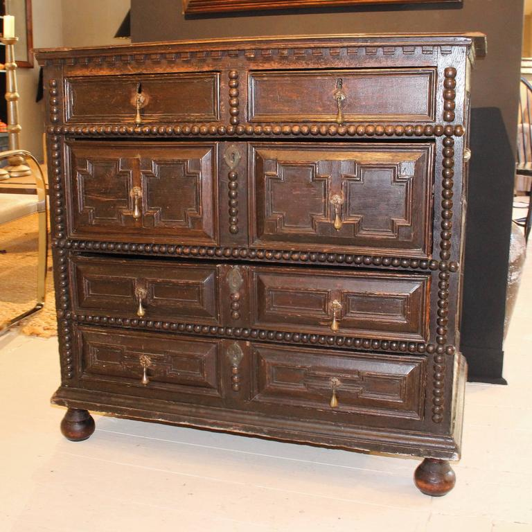 Period 17th-Early 18th century five-drawer pilgrim chest, Probably from Massachusetts or New Hampshire. Chest has dentil moulding and applied decorative turnings that are typical of furniture made in the Plymouth area.