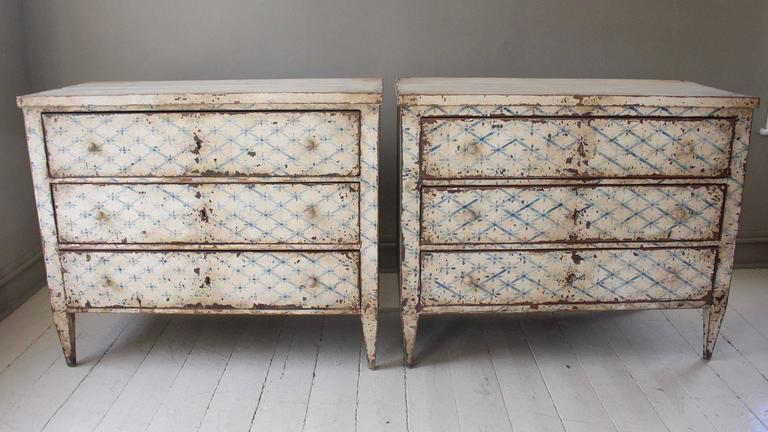 Louis XVI style paint decorated three-drawer chest, 19th century, France, sits on tapered legs. In later distressed oyster paint, the chest has a charming blue Trellis Design. Note: Only one chest is available - the one on the left in main photo.