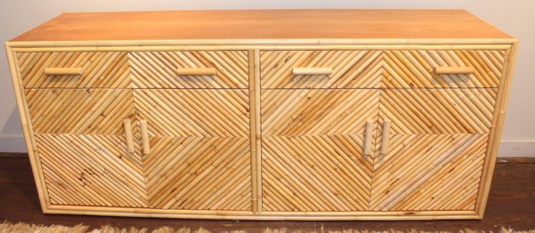Vintage sideboard, 20th century, of Mitered split bamboo with two drawers atop lower double-door cabinets, each with two shelves.