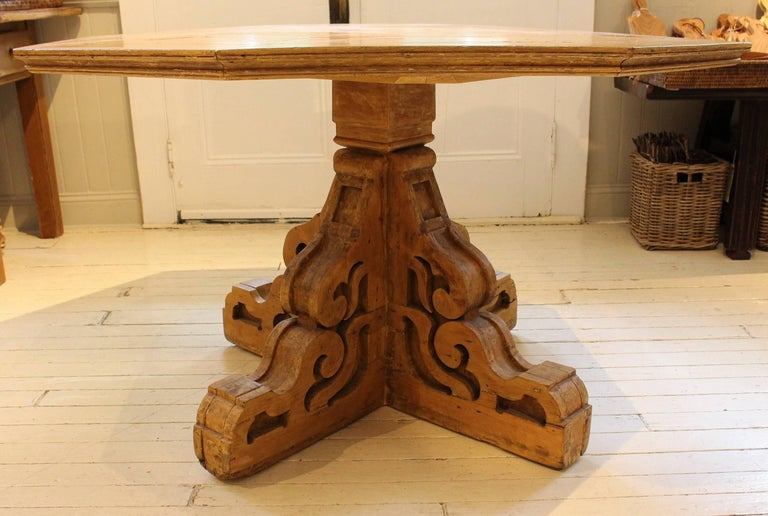 Folk Art table, 19th century USA, with octagonal surface engineered from Mitered boards atop curved bracket base.