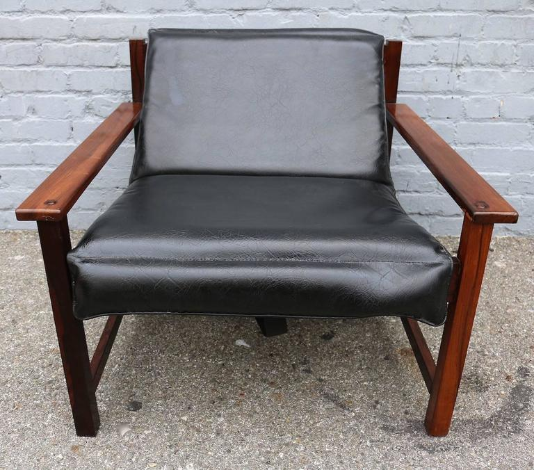 Pair of 1960s Brazilian reclining lounge chairs in jacaranda wood and upholstered in black leather.