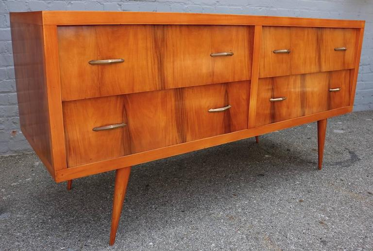 Brazilian 1960s sideboard in caviuna wood with brass details and four drawers.  Can also be used as a dresser