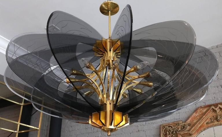 Dominici 1960s chandelier with 12 smoked glass pieces with decorative etchings on a brass frame.