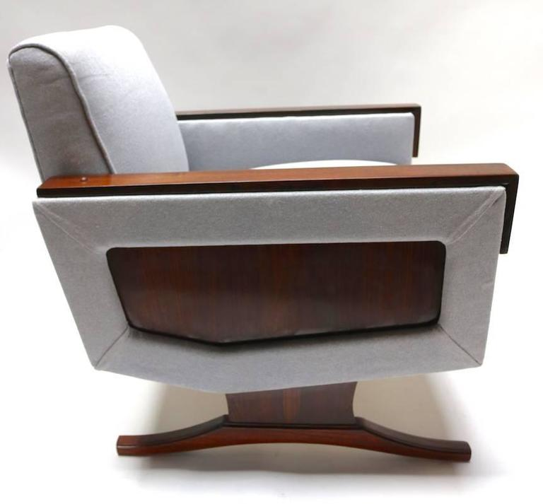 Pair of 1960s Brazilian armchairs in jacaranda wood with grey linen upholstery.