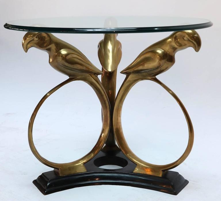 Brass and metal 1960s side table with parrot base and glass top.