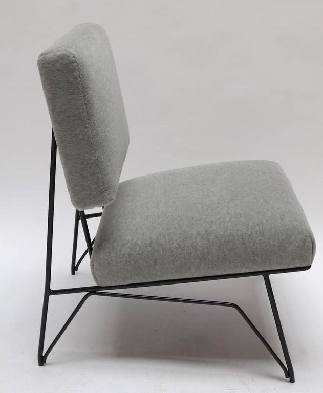 Pair of custom 1960s style slipper chairs with black metal frame, upholstered in gray alpaca.
