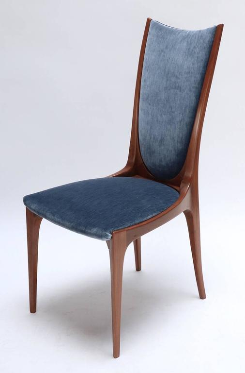 Set of ten Brazilian caviuna dining chairs from the 1960s with original upholstery.