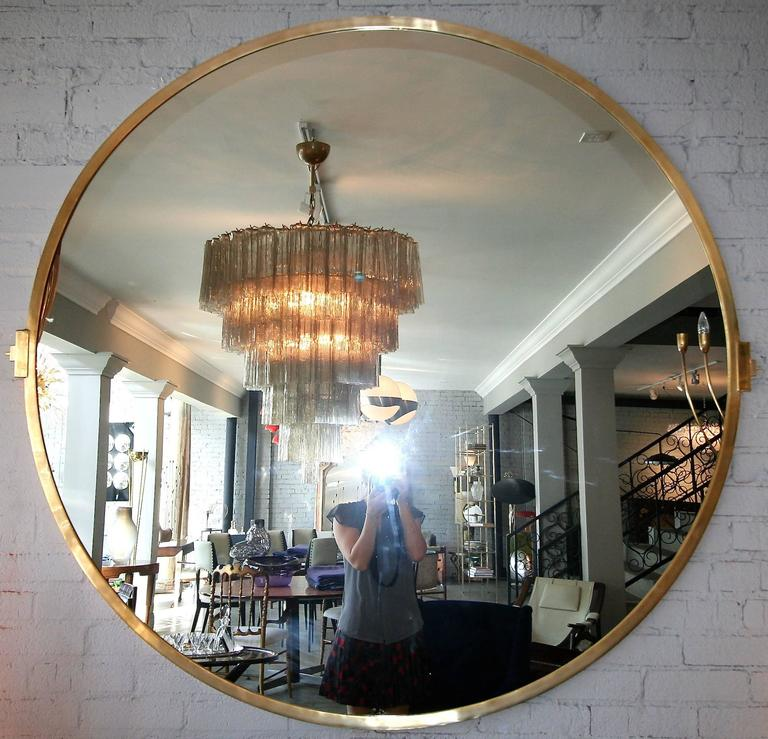 Large, custom 5-foot round brass mirror. Can be done in different shapes, sizes and metals.