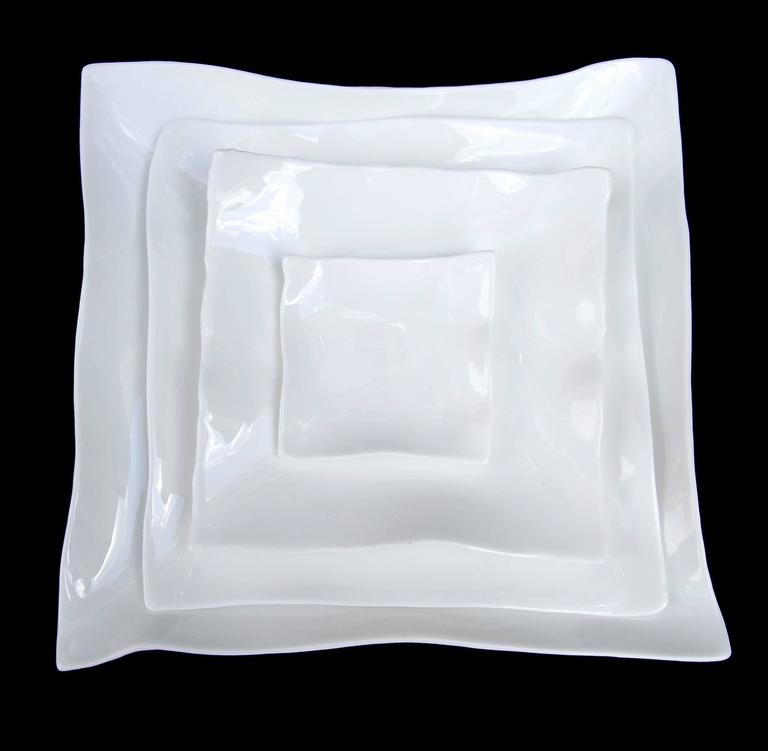 Square white bone china tableware by Roos Van de Velde from the line perfect imperfection for Serax. Priced individually.  Plates: Measures: Mini $24 (3.5