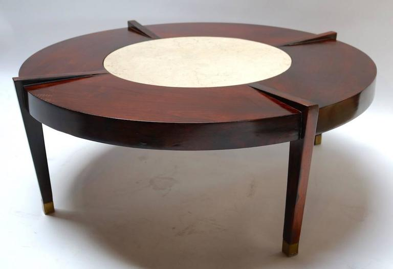 Round 1960s coffee table in Brazilian jacaranda wood with cream marble center and brass feet.