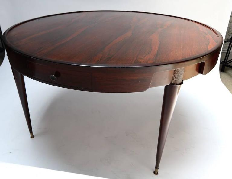 1960s Brazilian center table in jacaranda wood with glass top and metal details. Can be used as a card or dining table.