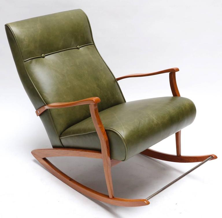 1960s Brazilian rocking chair upholstered in green leather.